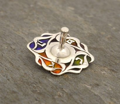 Sterling silver thin dreidel with swirling colorful deisgns. Hannukah Judaica gifts made in Israel