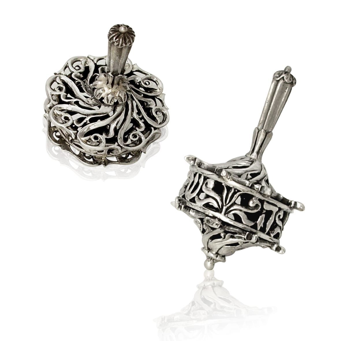 Sterling silver dreidel with cut-out, swirling designs. Hannukah Judaica gifts made in Israel