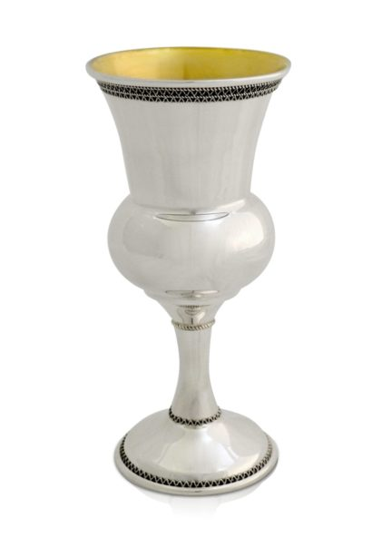 Sterling silver Kiddush cup with filigree tracery and a voluptuous shape