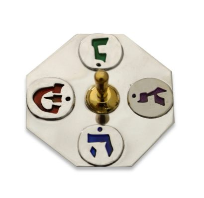 Thin sterling silver and brass dreidel with cold colorful enamel Hebrew lettering. Hannukah Judaica gifts made in Israel