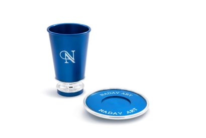 A kiddush cup and a branded plate with a business logo